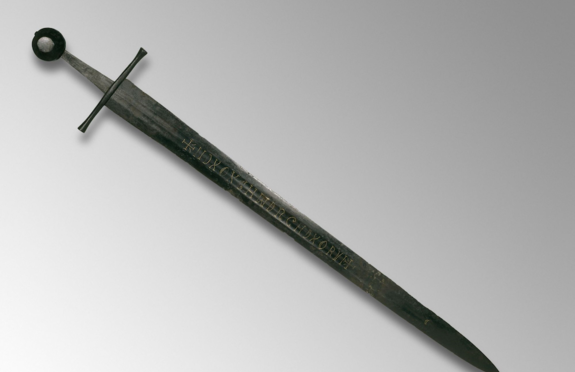 This 13th-century sword with a gold inscription was likely made in Germany, but was found at the bottom of the River Witham in 1825. Credit: The British Museum